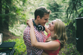 happy couple take engagement pictures in the dark forests of nisene marks surrounded by turntable and dj equipment