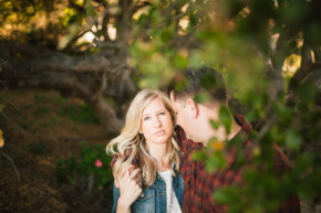 happy newly engaged couple portraits engagement session in davenport surrounded by green trees and beautiful light