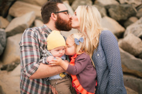 happy family on the beach kiss bear hug for family portraits