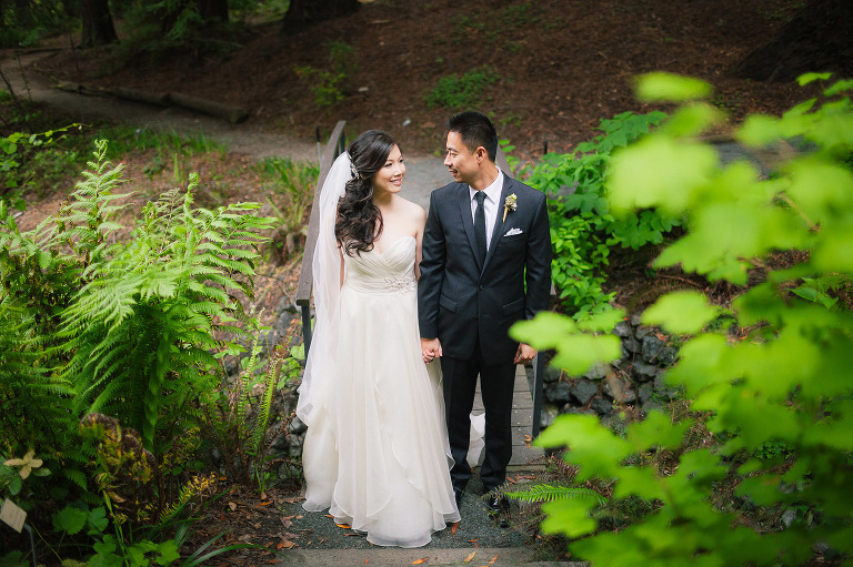 Happy Couple Hold Hands Bridal Gown Veil And Look At Each Other And Smile  Among The ...