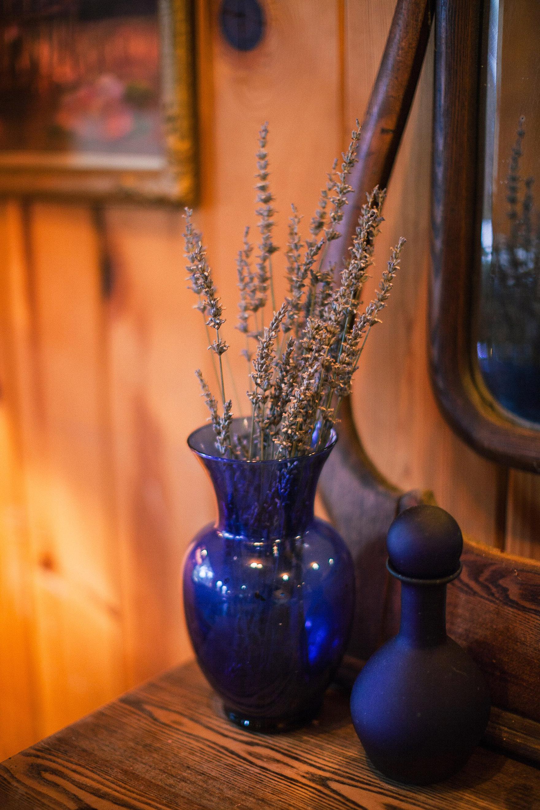 lavender sticks out of a vintage vase inside the cottage detail shot of this property redwood ridge estate wedding redwood ridge wedding the perfect santa cruz wedding venue los gatos wedding venue