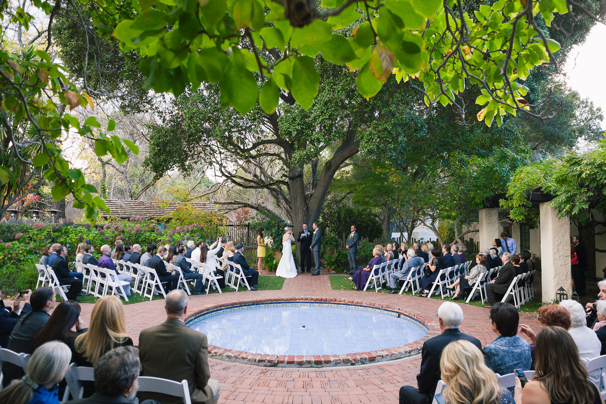 bride and groom get married during their ceremony celebration at their allied arts guild wedding venue